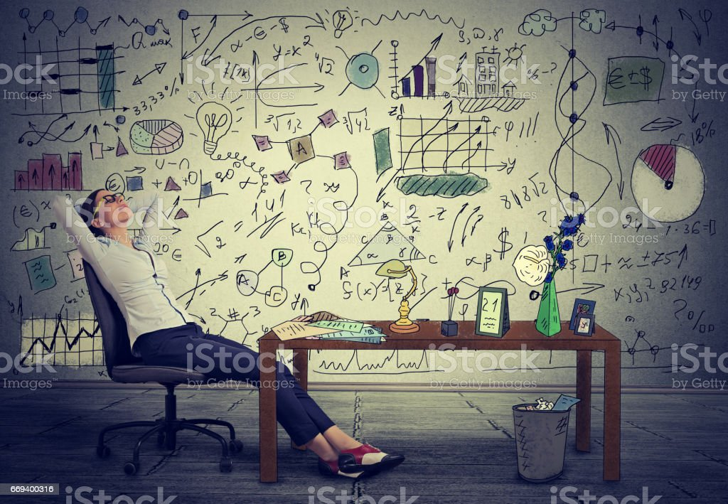 Young business woman relaxing at her desk in her office stock photo