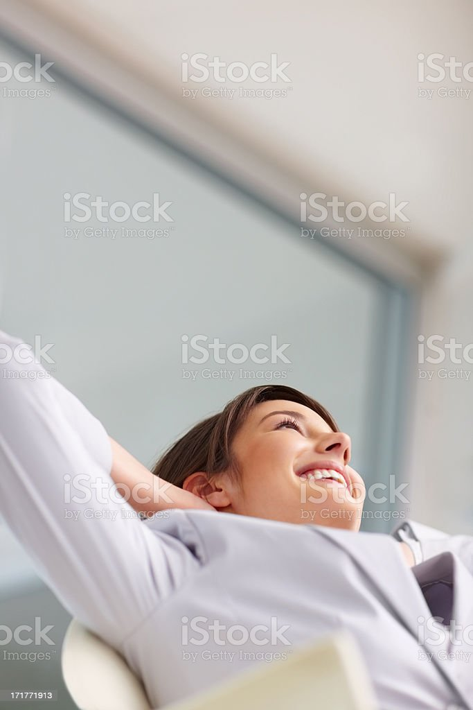 Young business woman relaxing, looking upwards stock photo
