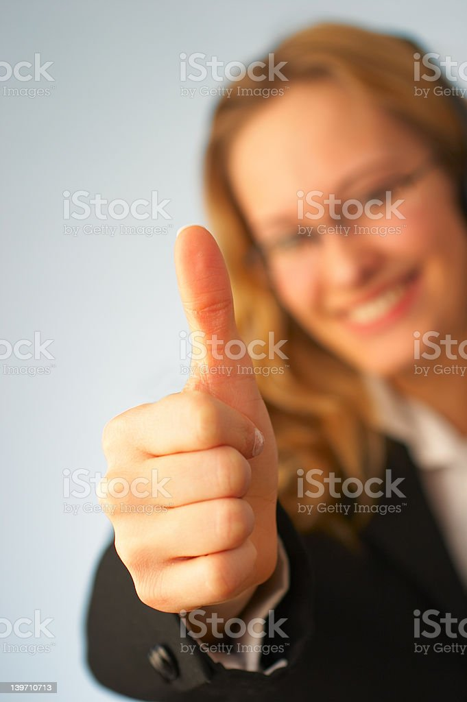 Young business woman showing thumbs Up sign royalty-free stock photo