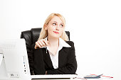 Young business woman sitting at desk at office
