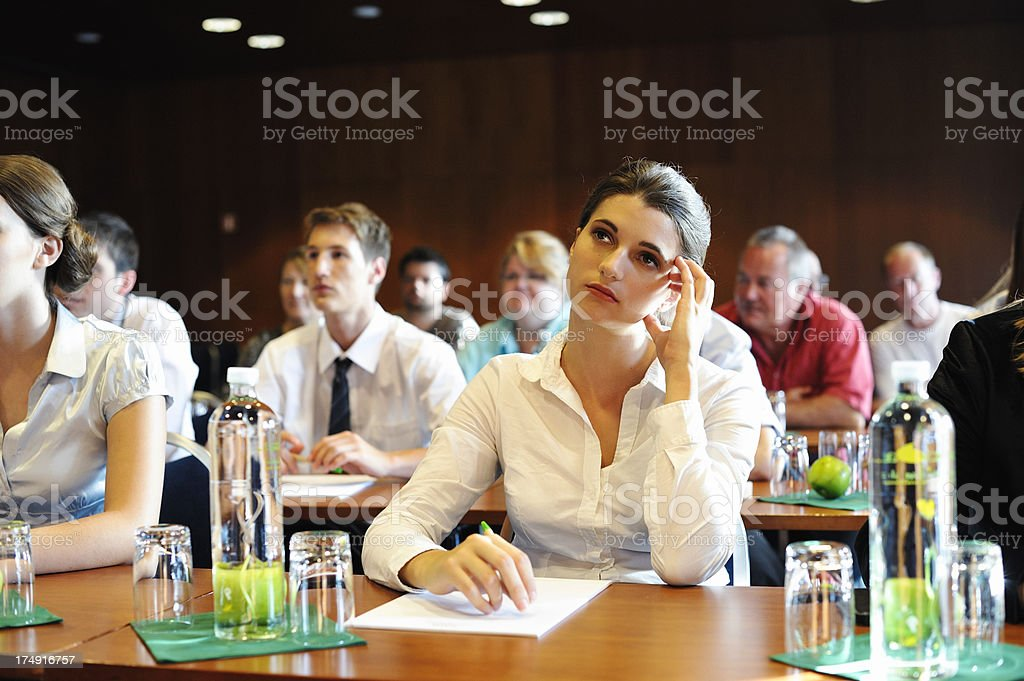 Young Business Woman Sitting in Conference royalty-free stock photo