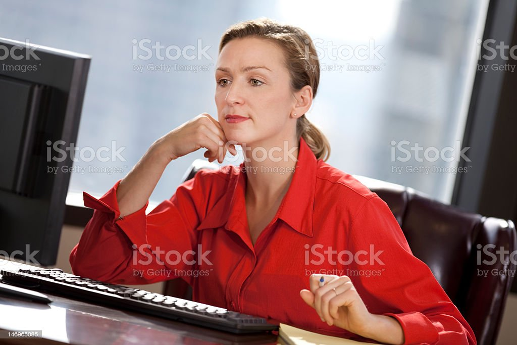 Young Business Woman Sitting In Office Looking At Computer royalty-free stock photo
