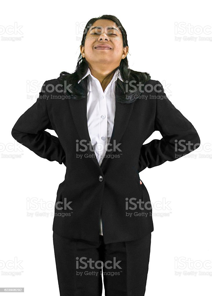 Young business woman suffering from back pain. stock photo