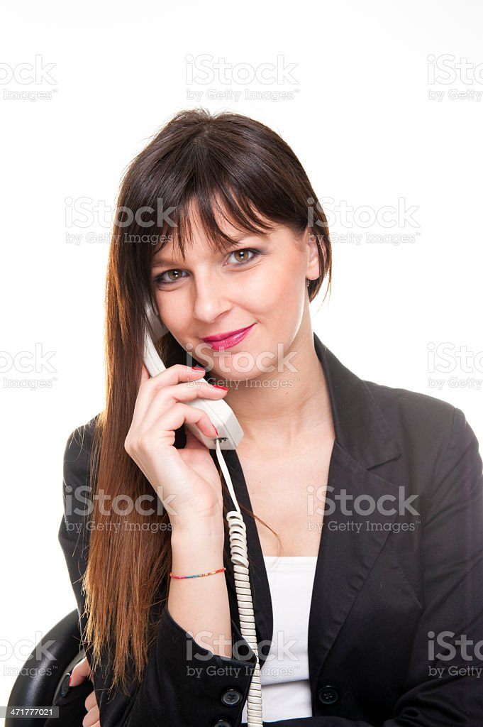 Young business woman talking at the phone on white background royalty-free stock photo