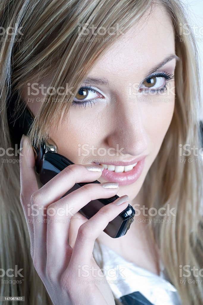 Young business woman talking on the mobile phone royalty-free stock photo