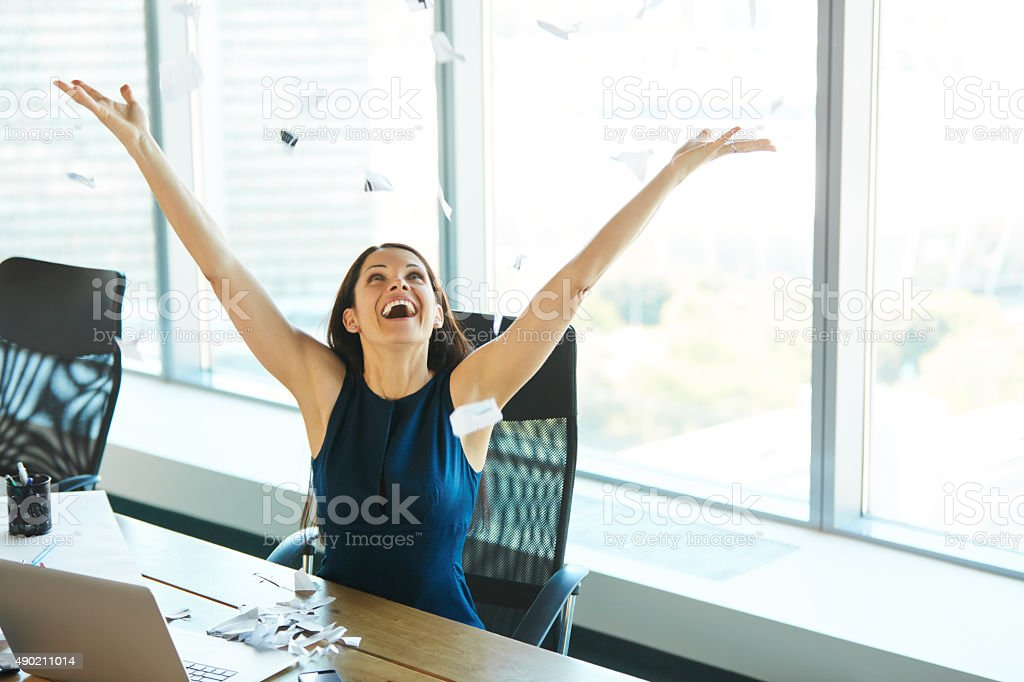 Young Business Woman Throwing Paperwork into The Air. stock photo