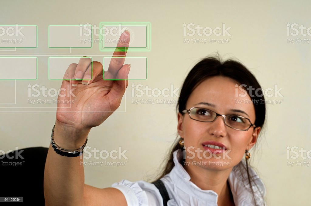 Young business woman touching transparent screen button royalty-free stock photo