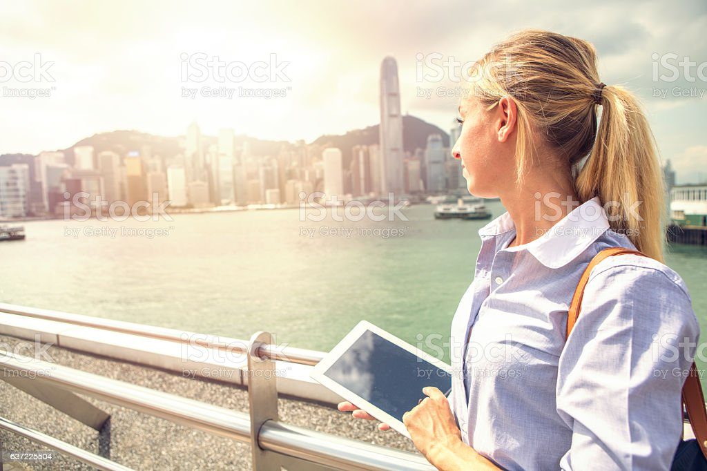 Young business woman using digital tablet, Hong Kong stock photo