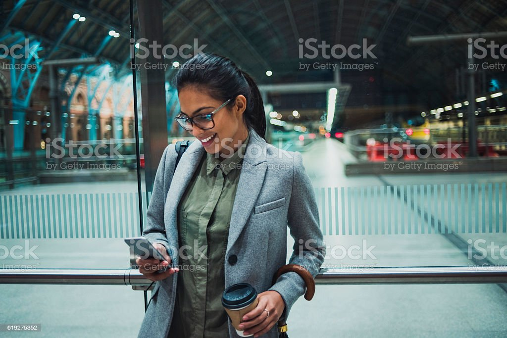 young business woman using her smartphone stock photo