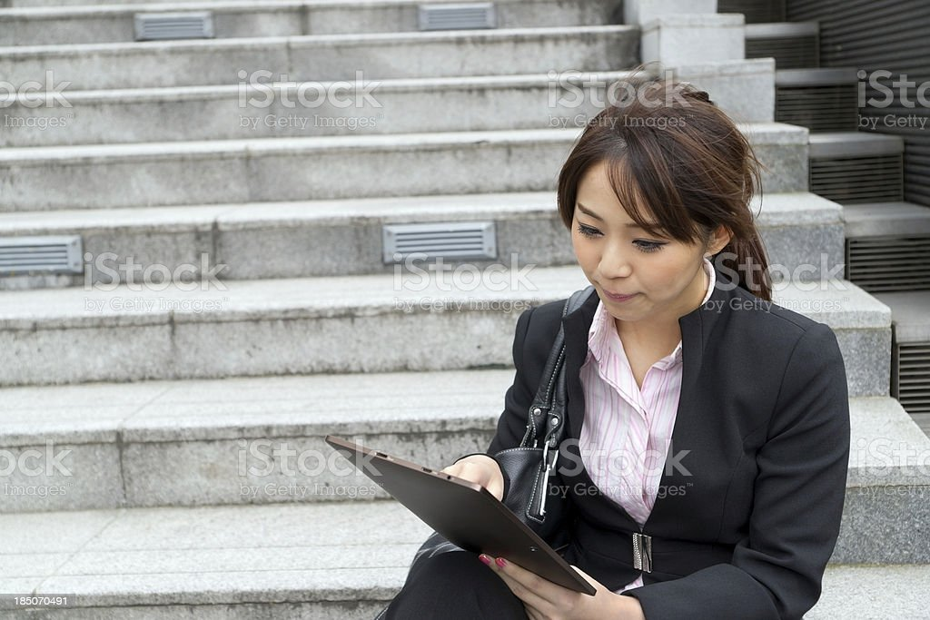 Young business woman using tablet royalty-free stock photo