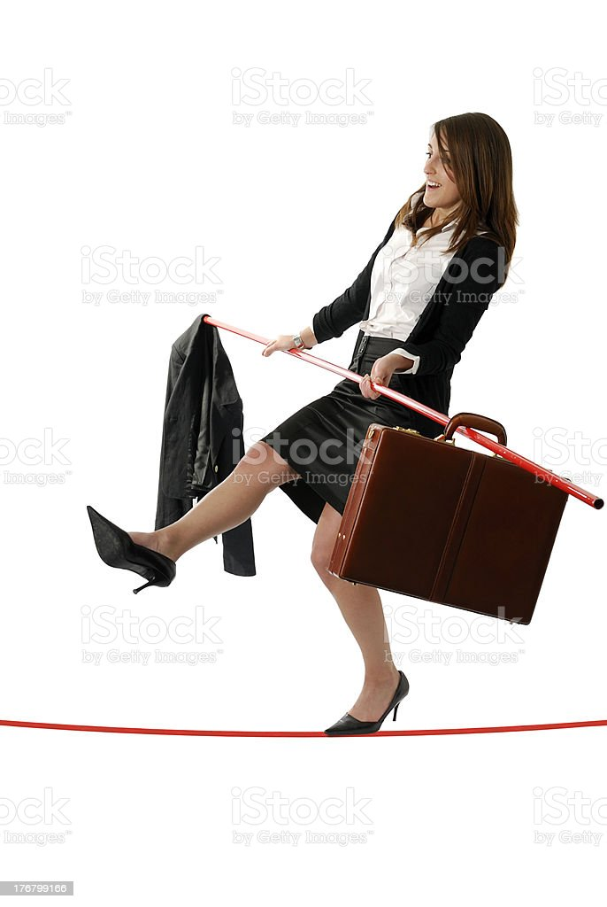 young business woman walking on a tightrope stock photo