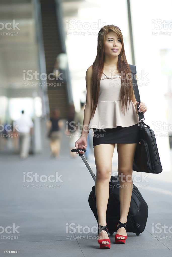 Young business woman walking outside of shopping plaza royalty-free stock photo