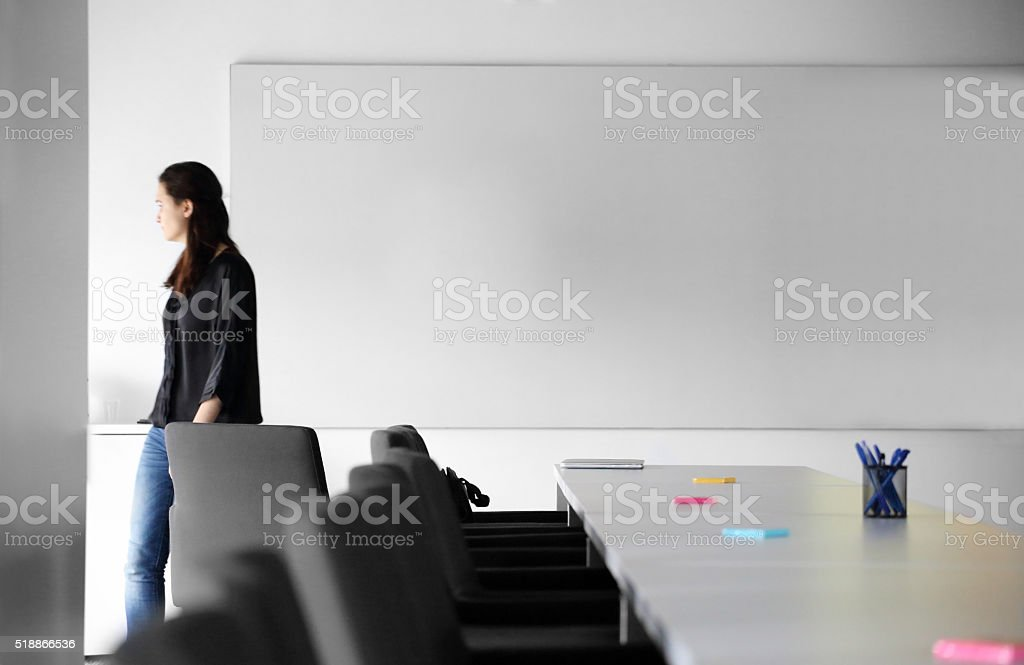 Young business woman walking stock photo