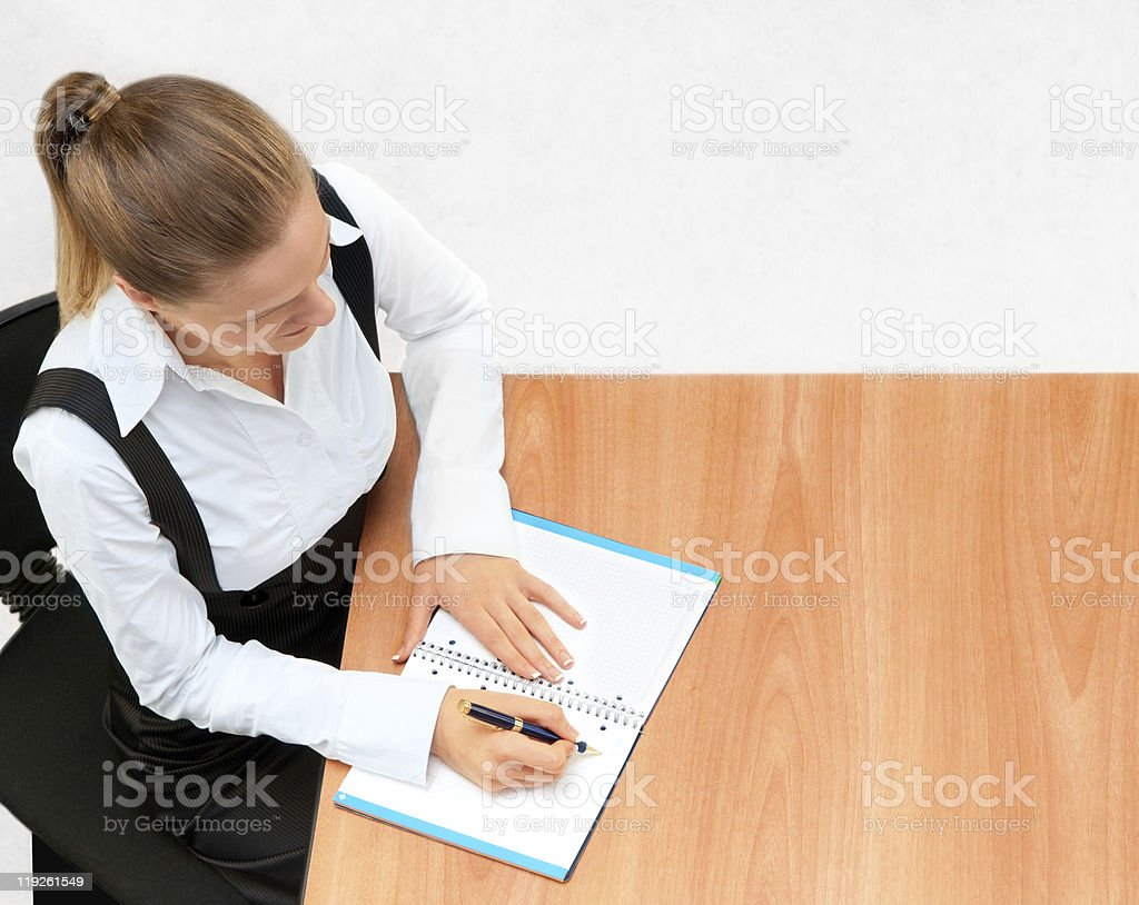 Young business woman while at work royalty-free stock photo