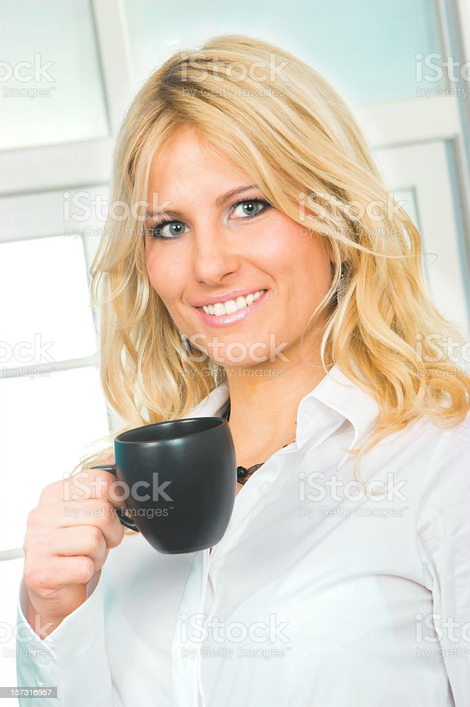 Young business woman with a coffe mug stock photo