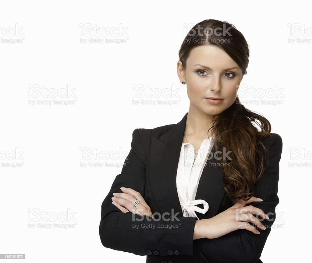 Young business woman with arms crossed against white royalty-free stock photo
