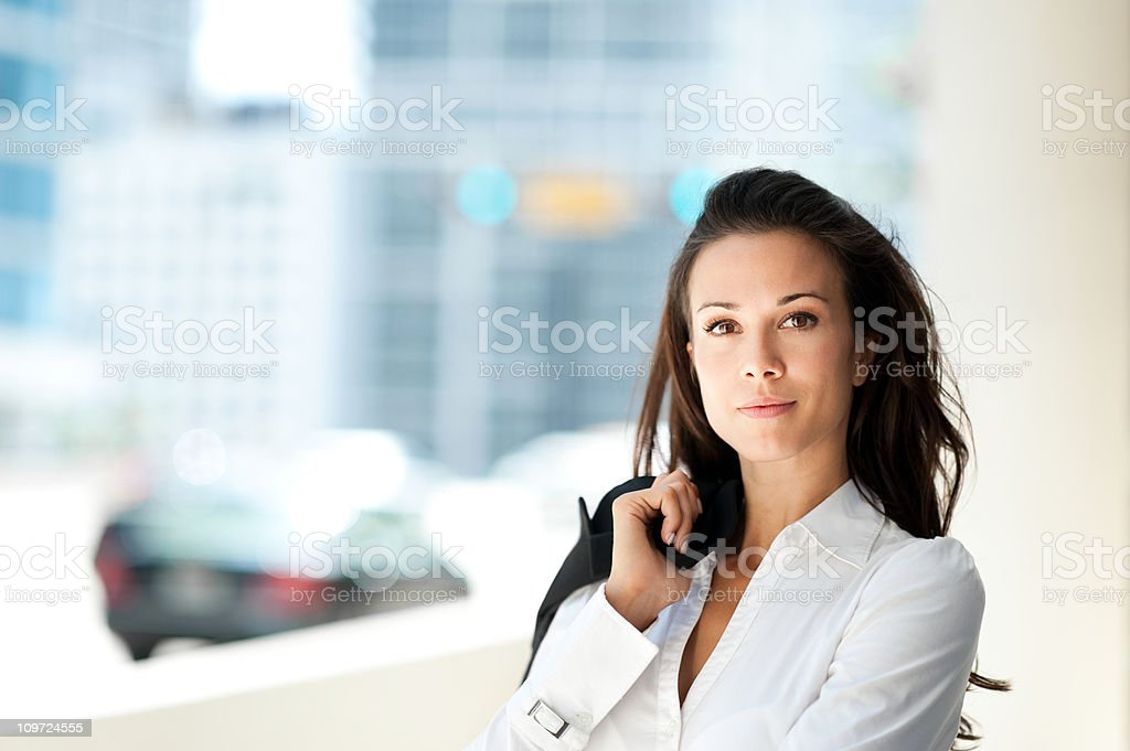 Young Business Woman with Coat over Shoulder royalty-free stock photo