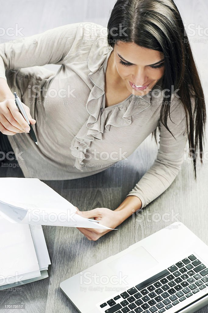 Young business woman with documents and laptop. royalty-free stock photo