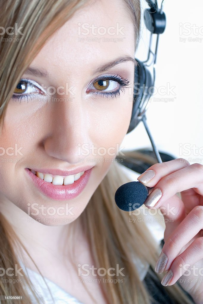 Young business woman with headphones and a microphone royalty-free stock photo