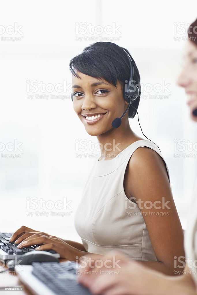 Young business woman with her colleague working in call centre royalty-free stock photo