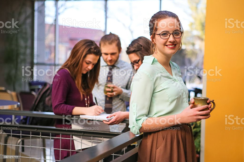 Young Business Woman with Her Team of Professionals stock photo