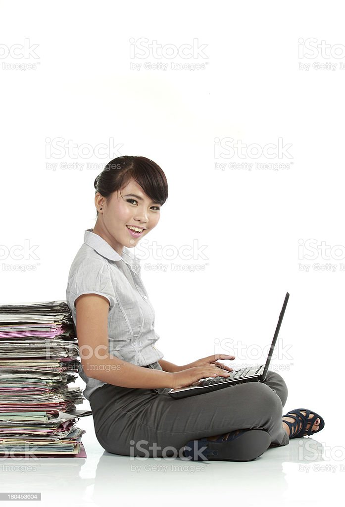 young business woman with laptop and papers royalty-free stock photo