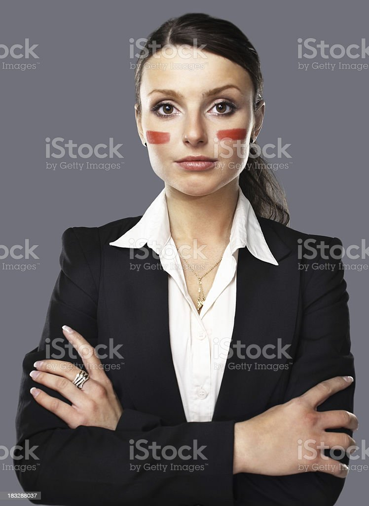 Young business woman with paint marks on her face royalty-free stock photo