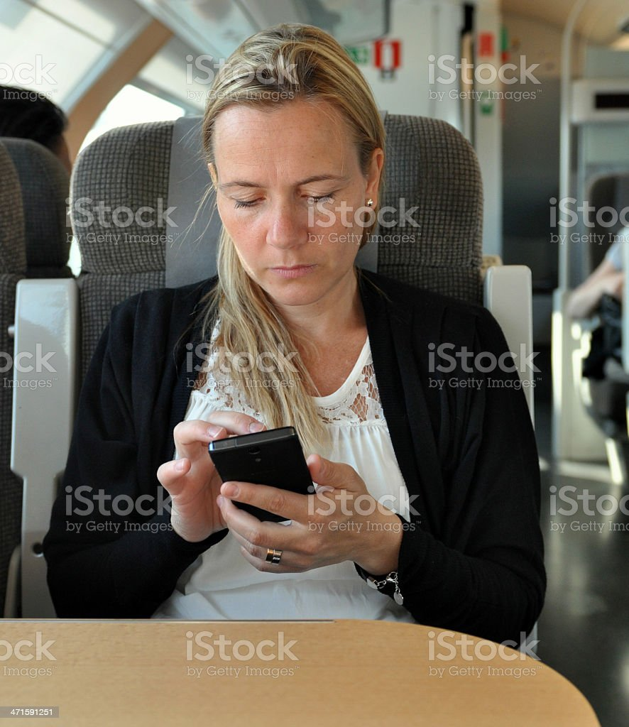 Young business woman with smart phone stock photo