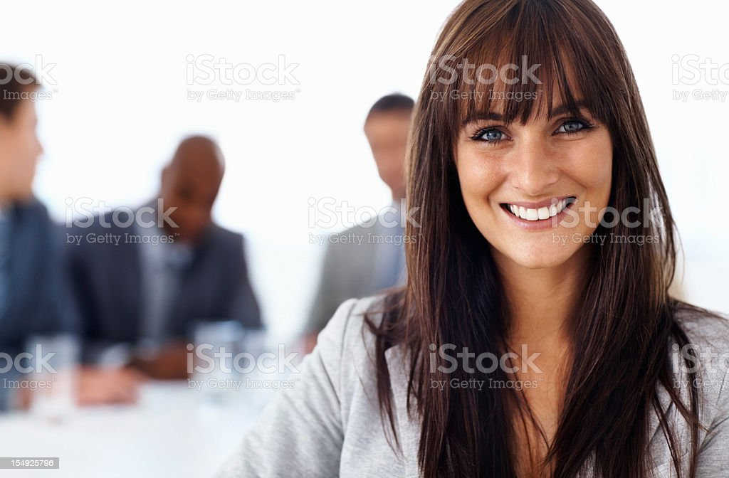 Young business woman with team in background royalty-free stock photo