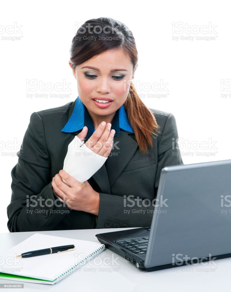 Young Business Woman With Wrist Pain stock photo