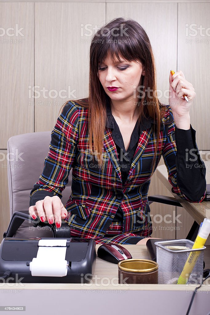 Young business woman working at the desk on office background royalty-free stock photo