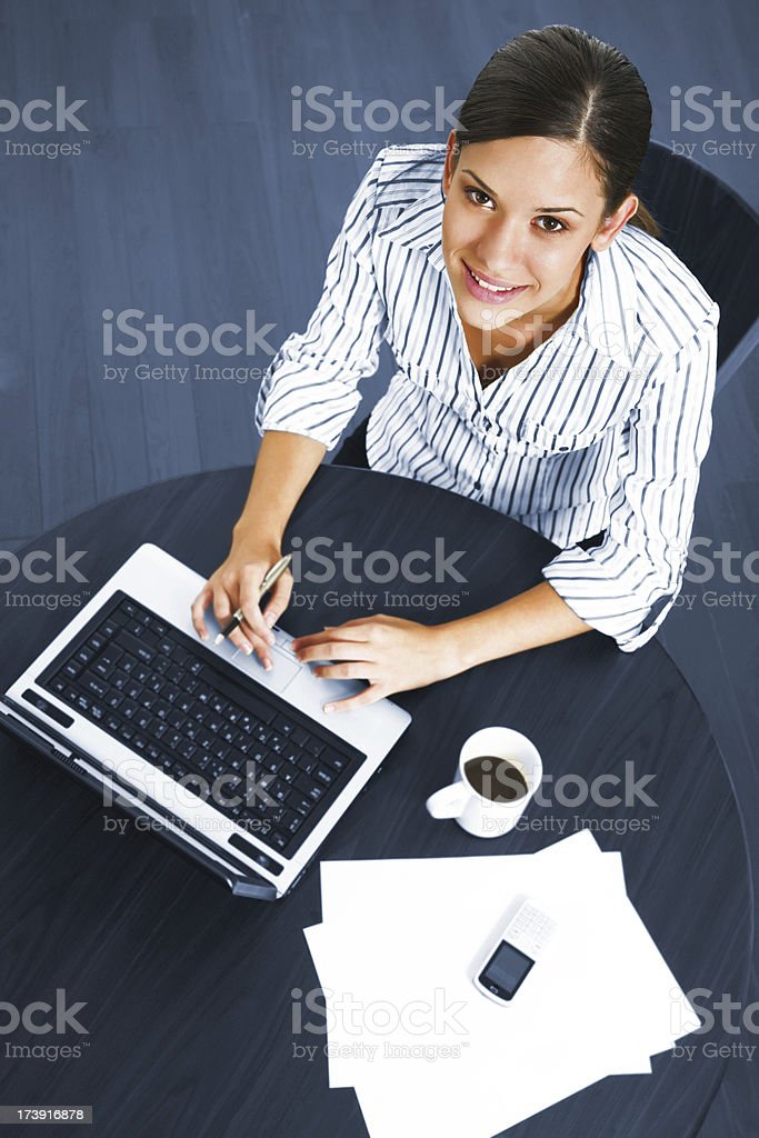 Young business woman working or studying at home royalty-free stock photo