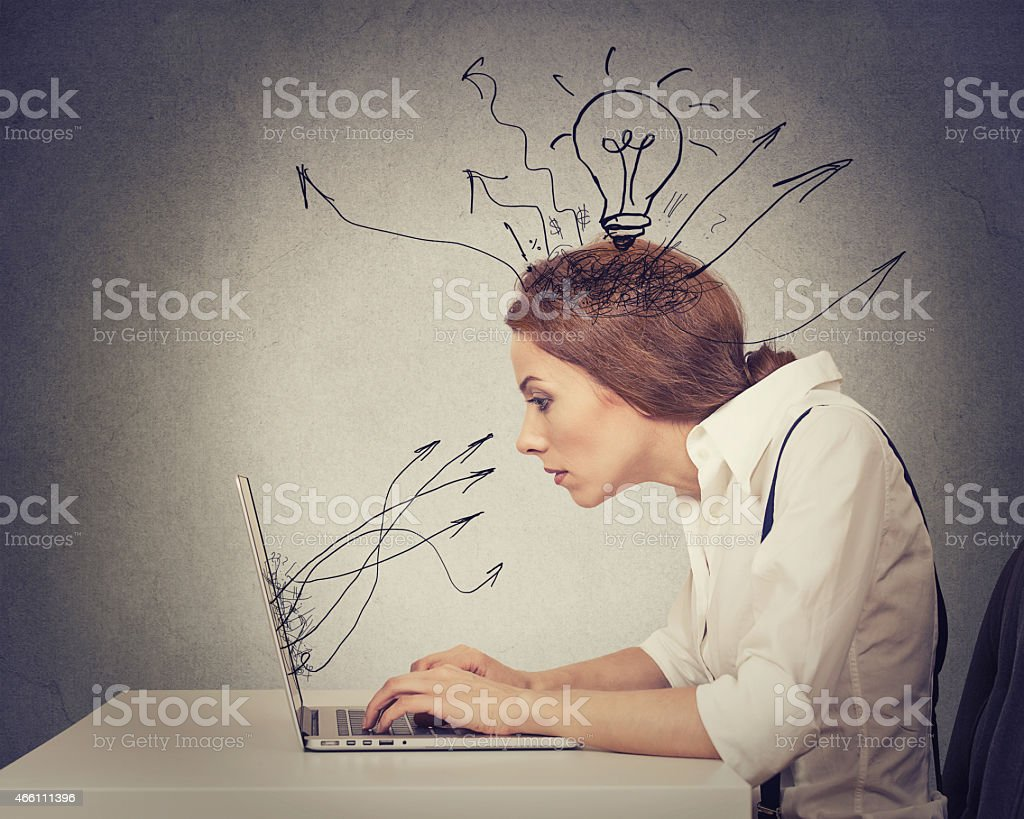 Young business woman working typing on computer in office stock photo
