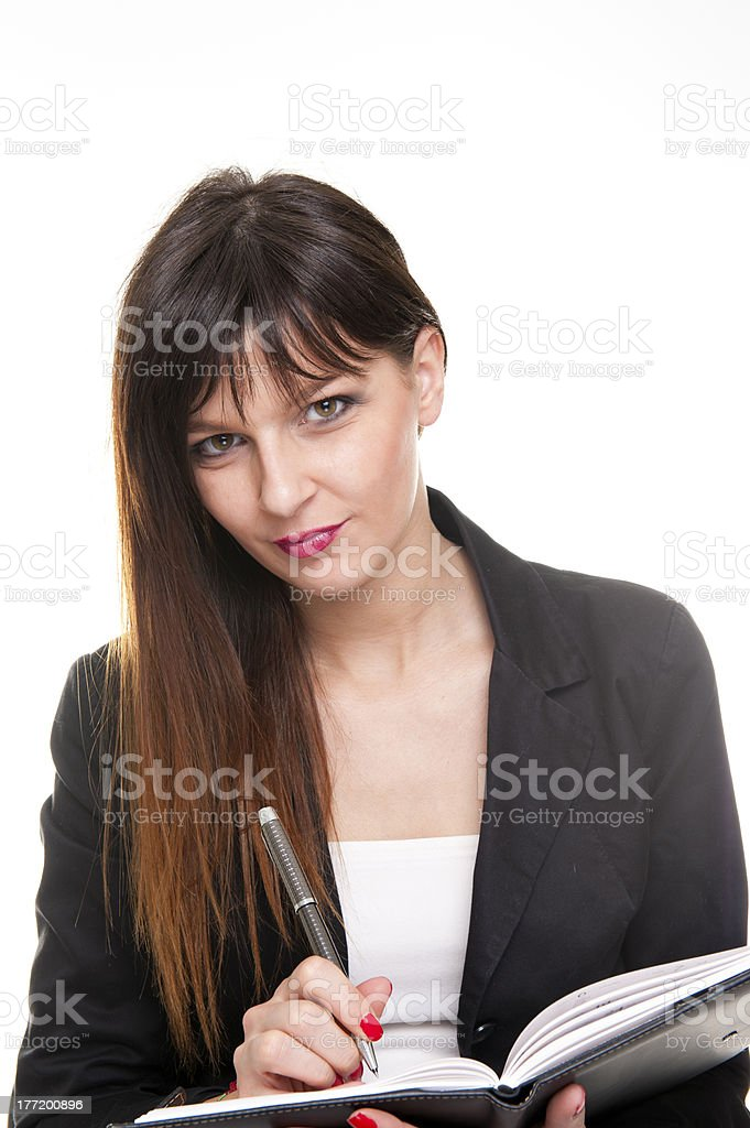 Young business woman write in notepad on white background royalty-free stock photo