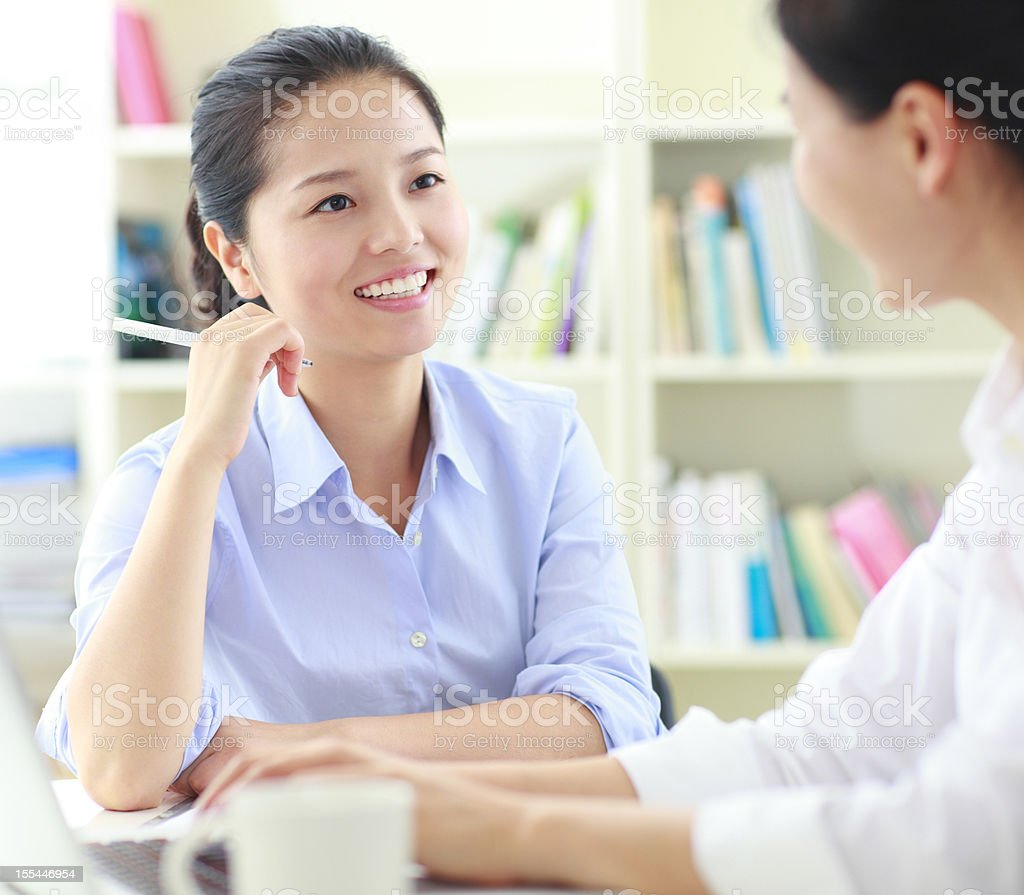 young business women discuss together royalty-free stock photo