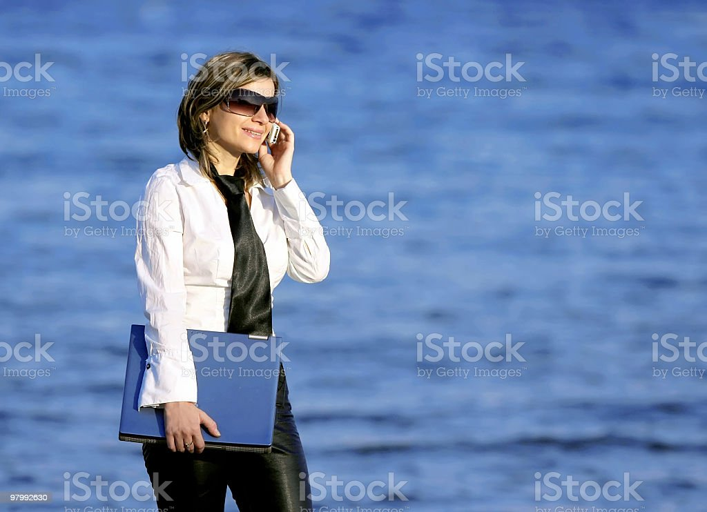 young business women holding laptop against sea royalty-free stock photo