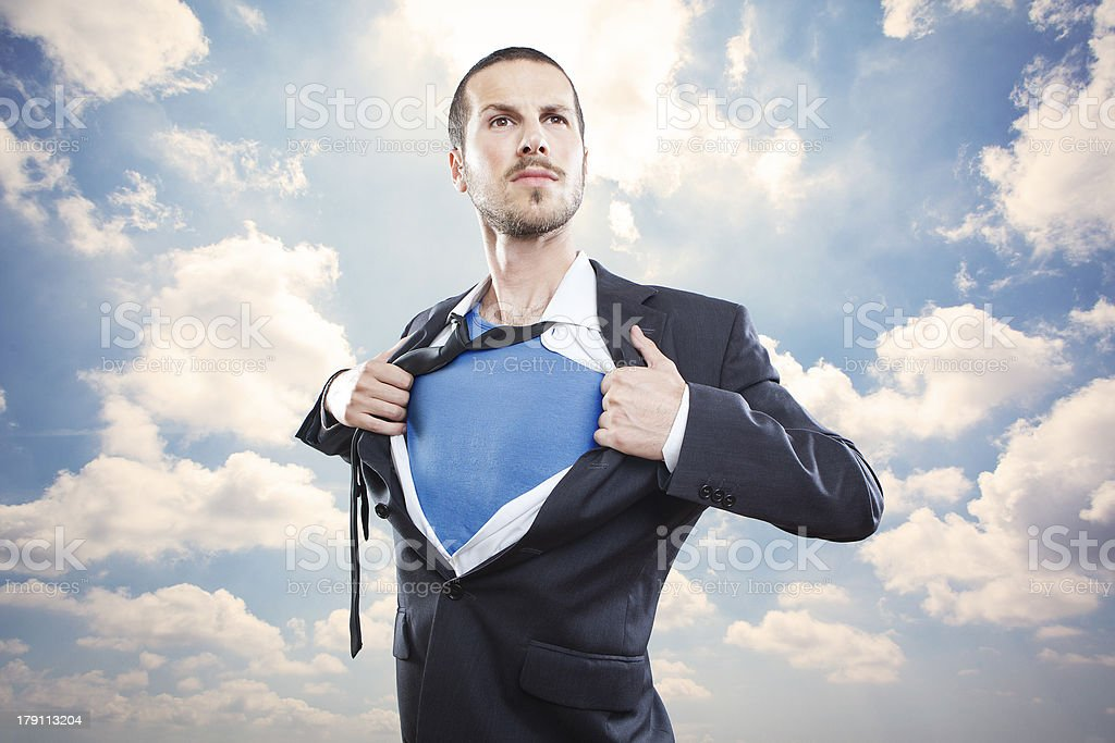 Young businessman acting like a super hero stock photo