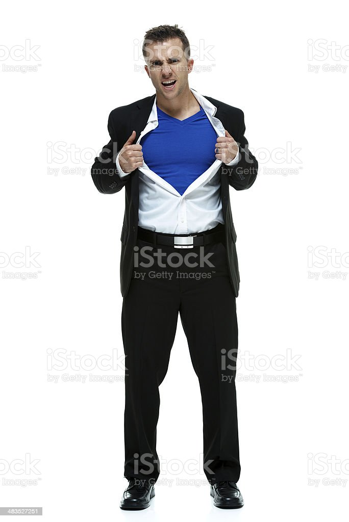Young businessman acting like a superman stock photo