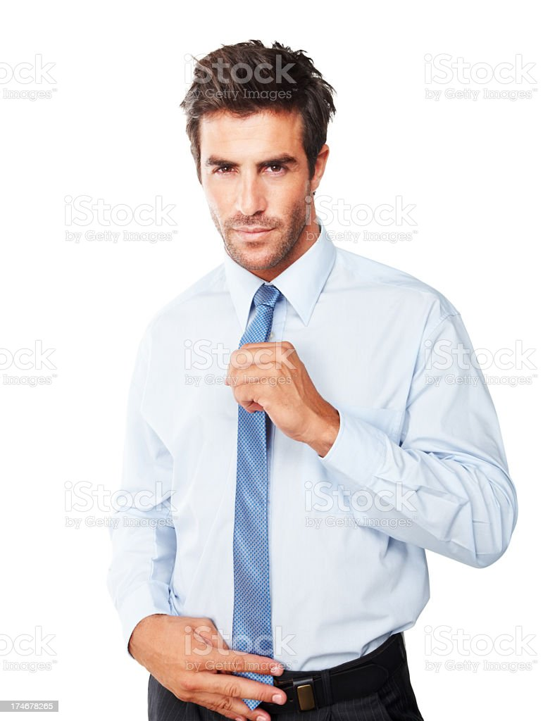 Young businessman adjusting his tie royalty-free stock photo