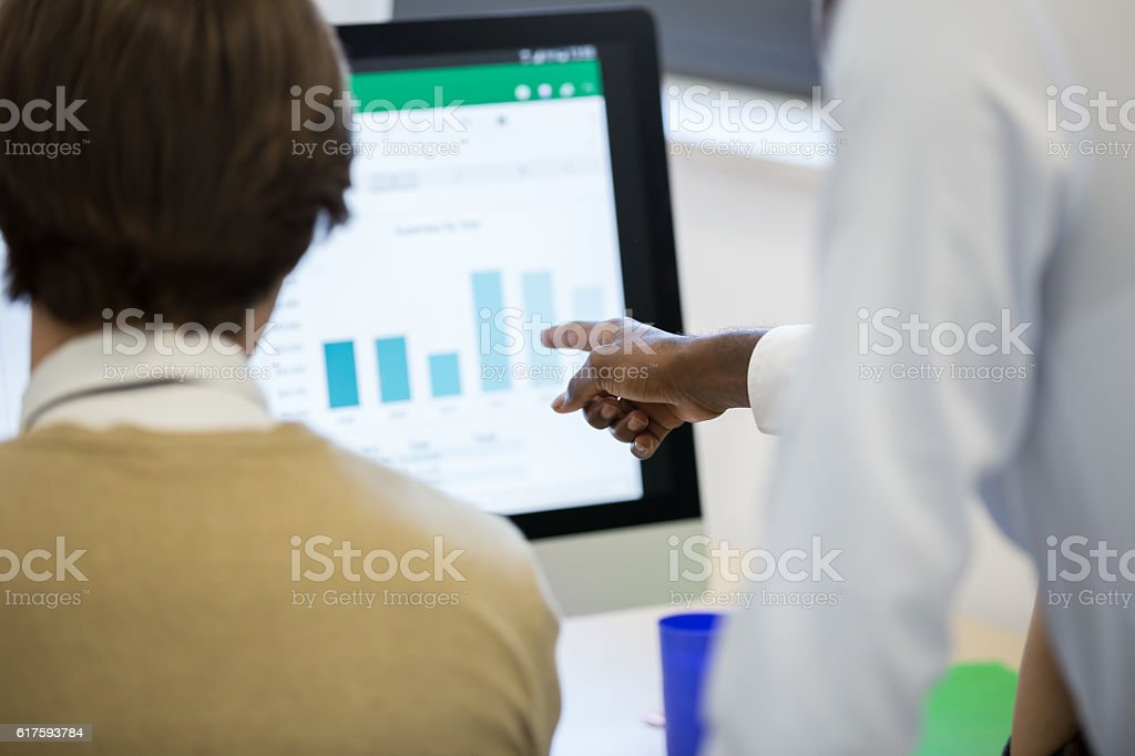 Young Businessman Analyzing Financial Chart stock photo