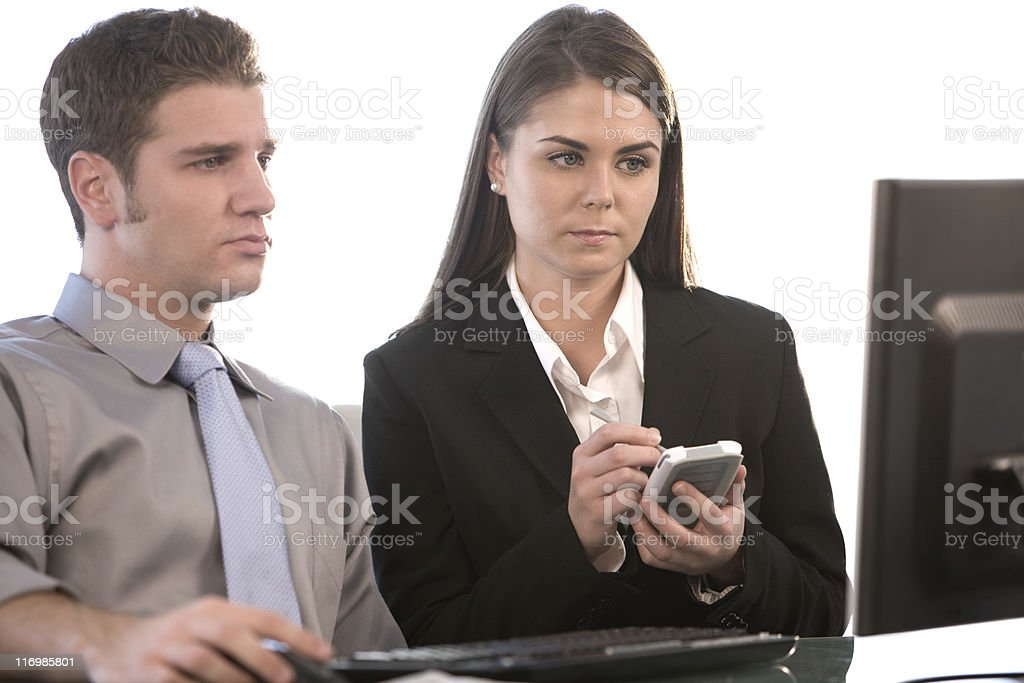 Young Businessman And Businesswoman Working royalty-free stock photo
