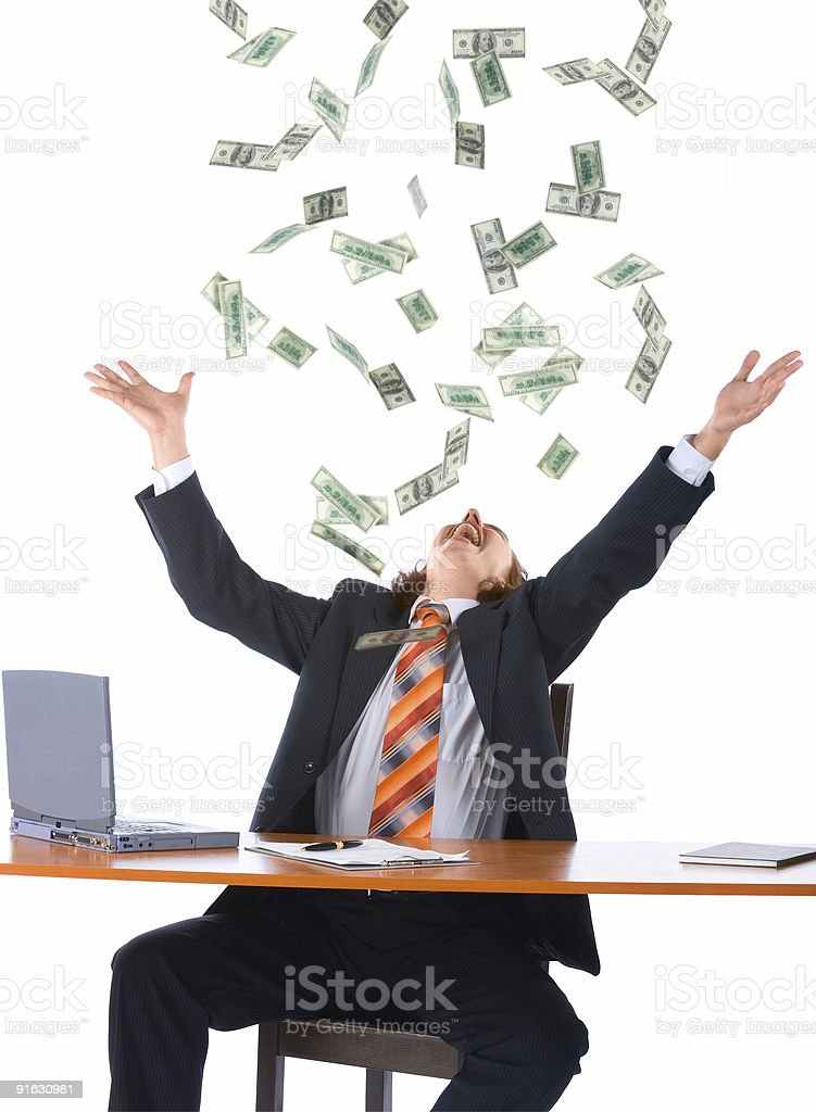 young businessman and falling money royalty-free stock photo