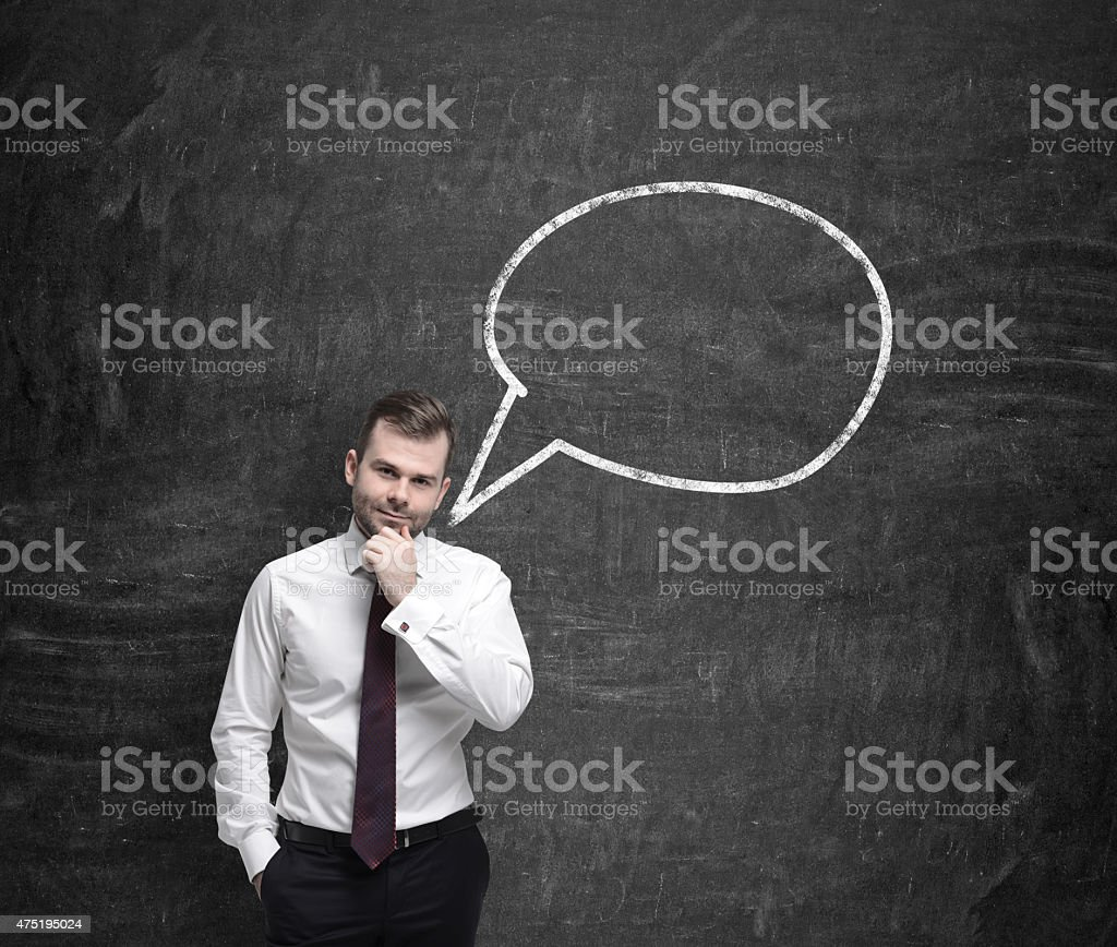 Young businessman and thought bubble stock photo