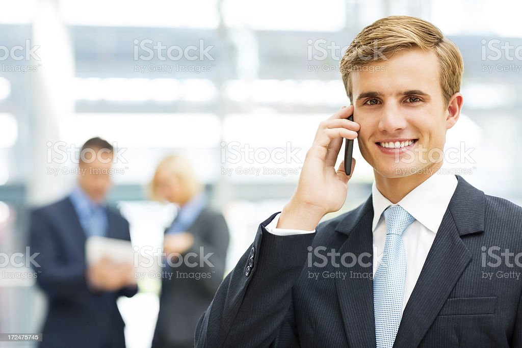 Young Businessman Answering Phone Call royalty-free stock photo
