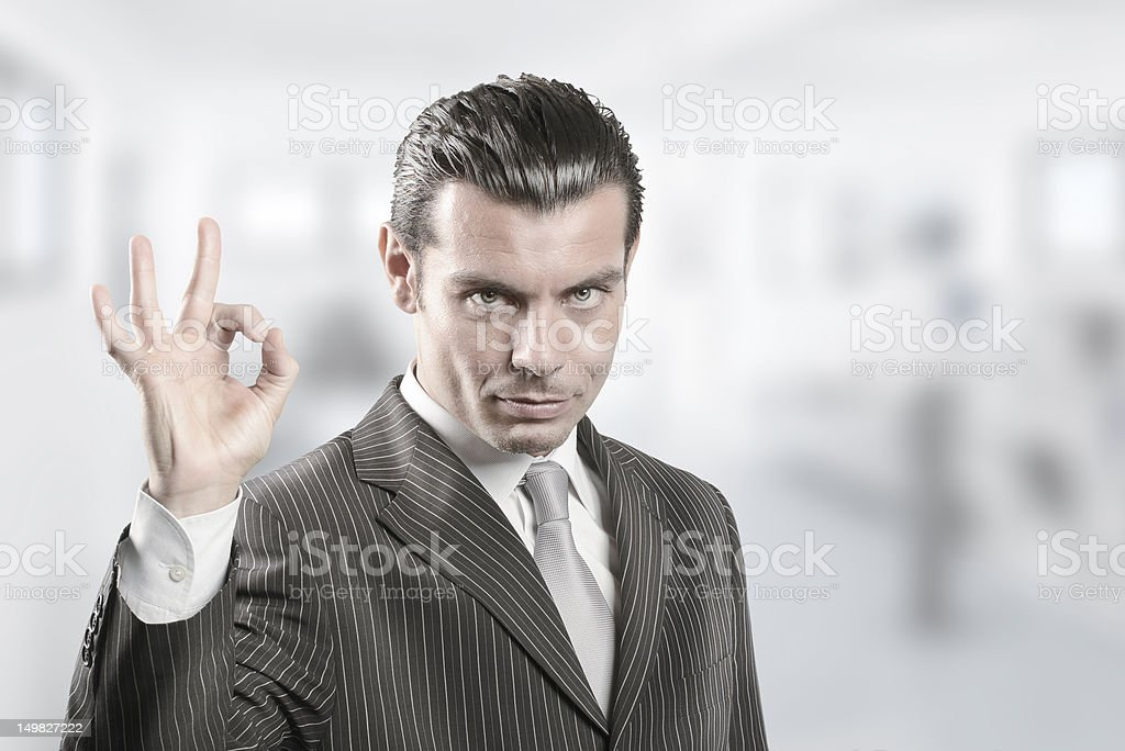 Young businessman approving with OK hand sign stock photo