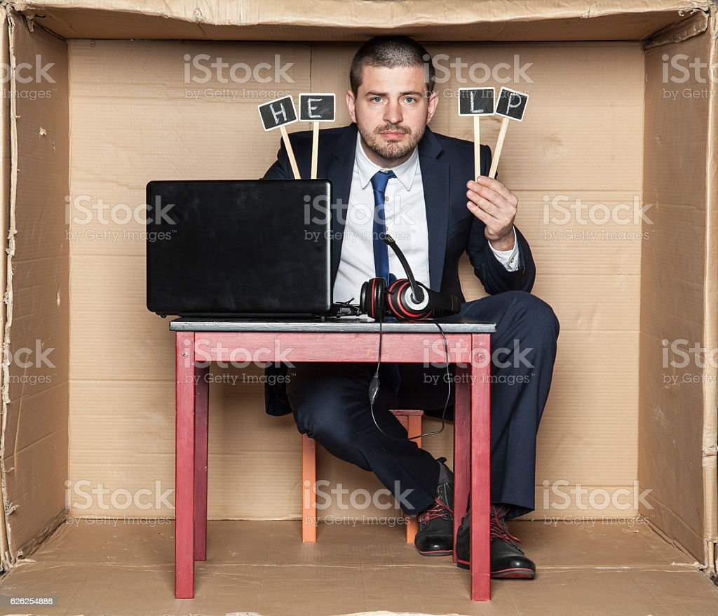 Young businessman asks for help at work stock photo