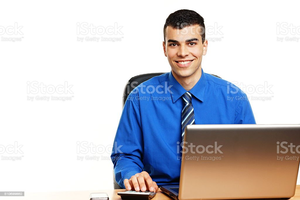 Young businessman at the computer stock photo