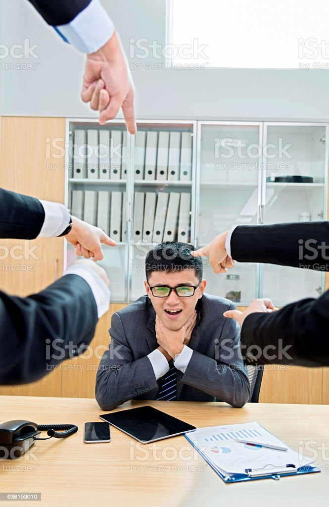 Young businessman being accused stock photo