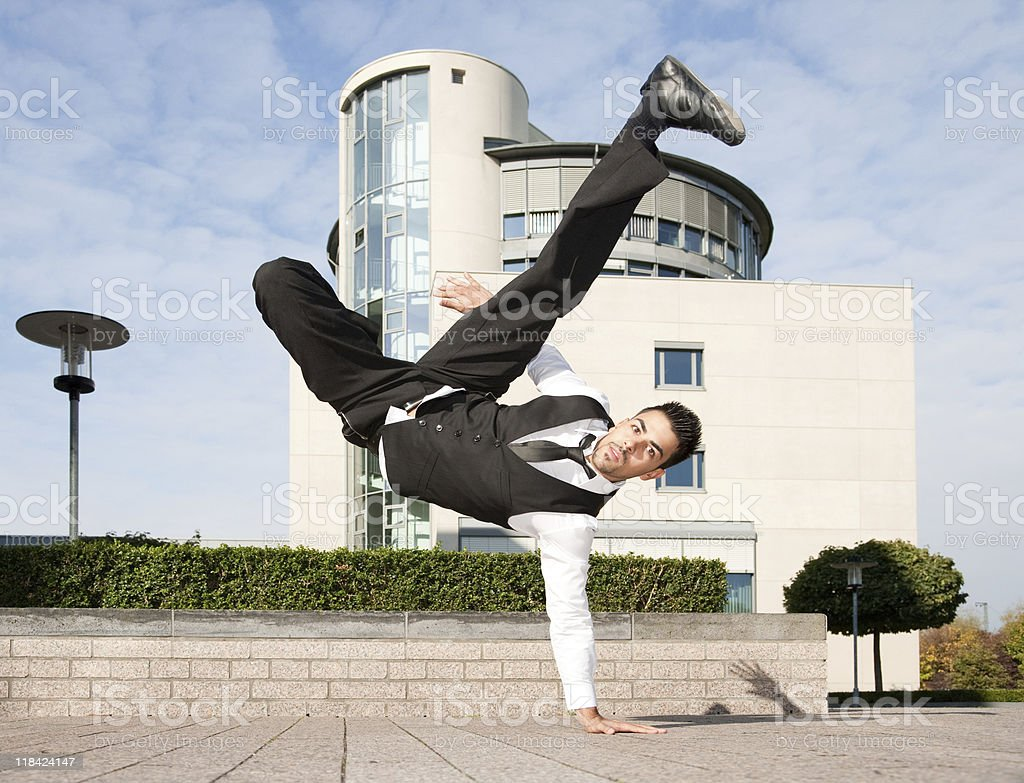 Young Businessman Breakdancing stock photo