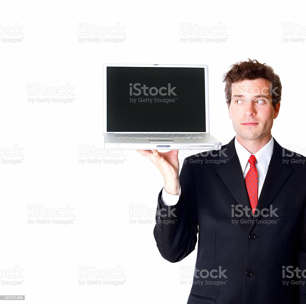 Young businessman carrying open laptop on one hand royalty-free stock photo